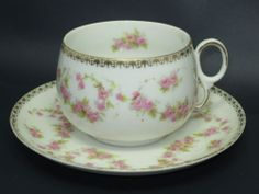 "This is the manufacturer of my first set of Bridal Rose.   As I pin more pieces, notice that the different countries and companies will vary their patterns and colourations of both the roses and the gilding around the rims of china.   I am vary partial to this ""lace"" edging.   AP Czechoslovakia Bridal Rose CUP AND Saucer 2G 