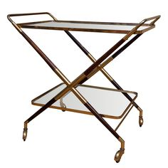 Cesare Lacca Beverage cart  Italy  c1940s  Cesare Lacca attributed beverage cart. Cross-legged brass frame with rosewood elements on casters; two tier glass trays.