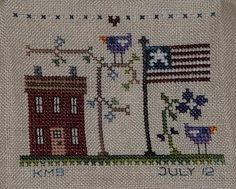 stitched freebie: little house from the floss box.  stitched with hand dyed floss.