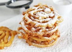 Mini Funnel Cakes!!! 2 cups bisquick, 1 cup milk, 2 eggs.  1 inch vegetable oil in a sauce pan.  Combine ingredients and pour into squirt bottle.  Once oil reaches 350-360 degrees, Squeeze batter in a circular motion close to oil.  Fry for 30 seconds on each side until golden brown.  Transfer to paper towel with slotted spoon to drain.  Sprinkle with powdered sugar and enjoy!!!!