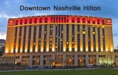 """The all-suite """"Downtown Nashville Hilton"""", a part of one of the most recognizable hotel chains in the world, is located at 121 Fourth Avenue South. It is conveniently situated to both the Bridgestone Arena and the Country Music Hall of Fame and Museum. Want to do some honky-tonking while visiting? That's all just a stone's throw away, too! Find this image and more for sale at  marian-bell.pixels.com  and at  marian-bell.fineartamerica.com  More items for sale at…"""