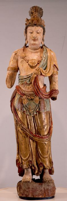 Guanyin Artist: unidentified maker Region: China Period: Jin Dynasty (1115-1234) circa 1175 Material: wood, gesso, pigment Dimensions: 91 in. high On view in the museum