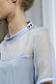 Here's a photo of a simple short stand up collar on a shirt. I believe any…
