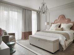 Delicate and rich looking master bedroom. This luxurious Swiss chalet has been completely redesigned by the renowned interior designer Kelly Hoppen