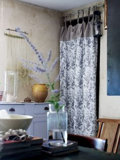 A curtain inside the front door – love the fabric.