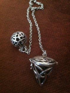 Magical opening cage pendant with star design and lapis lazuli spirit gemstone