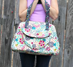 Whether you have a new baby or just have a ton of stuff to carry around in your bag, this one is for you! On the exterior, this bag features two elastic pockets, a snap pocket, and a back zippered pocket. On the inside, there are four elastic pockets and a zippered pocket. All of your things will have their special place! The bag is finished using bias tape on the lining side, so there is no hand sewing necessary! The pdf pattern includes 16 pages of sewing instructions, complete with 33…