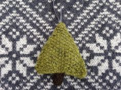 I decorate my home with these knitted Christmas Trees during the holiday season..  They measure about 9cm wide x 11cm high when stuffed..  You