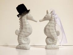 #Seahorse cake toppers - perfect for a beach #wedding!  I have seen them listed for $70+ online, but I just bought ceramic salt-and-pepper shakers (only $15!) and added a hand-sewn felt top hat and tulle veil.