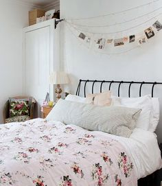 Completely ignoring the feminine decor, string black and white photos above the bed