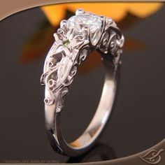 What I love most about this ring is the leaf pattern. I would love this with a heart shaped stone. I really like heart shaped stones