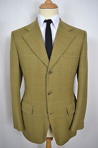 A VINTAGE 1960's MAENSON PURE NEW WOOL CHECK BLAZER.    Item Description:        A MEN'S UK MEDIUM 40 REGULAR FITTING (detailed measurements given below). Brown colour with a hint of green with a green check colour. Triple buttoned (all original). Flapped pockets at the waist and a slit pocket at the left breast. Single button cuffs. Made from Pure New Wool. Green/grey lining with two inside pockets. Genuine 1960's British vintage made by Maenson. Excellent condition.