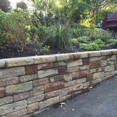 Random segmental retaining walls are popular choices for a sloped front entry