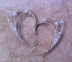 This is the style I would get with any number of gem beads used....so delicate.  Custom silver elf ears by Belethil on Etsy