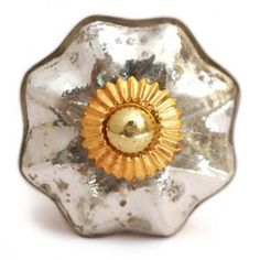 Enhance your cabinets and furniture with this mercury silver glass knob with an antique metallic finish.