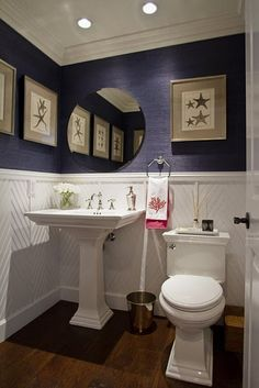 Love the look of this bathroom, the framed prints make the room...