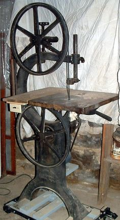 way old band saw. He was so proud the day he brought this home! Grandpap and daddy had a workshop in grandpaps first floor. It was in a barn shaped brick building and they lived upstairs. I played in the shop all the time collecting woodshaving curls to put on my made up dolls. The shop smelled of new wood and machine oil. Loved spending time there from the time I was three till I was five yrs. old.