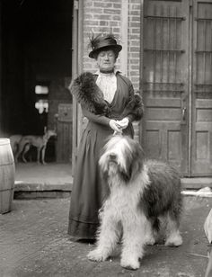 Miss Mary E. Patton. Dog Show, 1915. One of many images from the Washington dog show of 1915 showing fancy canines and their even fancier owners. Harris & Ewing Collection glass negative.