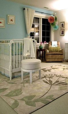 Baby nursery with floral area rug
