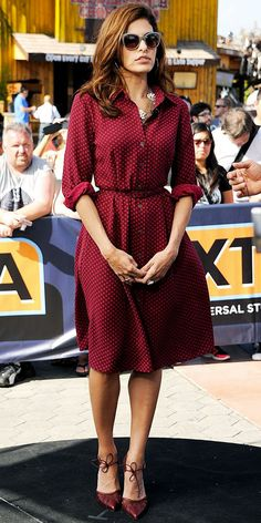 Eva #Mendes looks fab in her own dress design for New York Company! Love the #maroon color and rolled-up sleeves