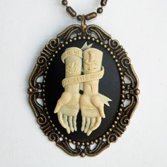 """Je Ne Regrette Rien"" Unique, tattoo inspired cameo featuring adorned, outstretched arms with a banner that tells the world ""I regre..."