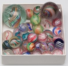 assorted antique marbles.  The one on the upper right side  is like mine.  Over 100 years old.