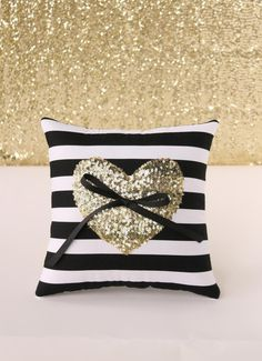 Ultra cute black & white ring pillow with gold sequin heart in the center.  I love this!   http://emmalinebride.com/color/black-and-white-wedding-color-board/