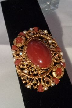 20% Off Florenza Carnelian Colored Stone Brooch - Absolutely Fabulous! After you use the coupon code the price becomes $27.20 instead of $33.99. Free Shipping to the United States. All of the items are on sale today only. This is the last day of the sale. Plus if you use the coupon code of 4152016 you get free shipping as well. Have a great vintage day! Best, Coco