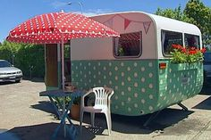 Trelise Cooper Caravan - The mint-green caravan comes complete with 600 polka dots, a bicycle, and planter boxes