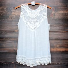 A cute oversized flowy ivory colored bohemian lace top. Soft ivory toned sheer yoke upper lace adorns this darling flirty vintage style sleeveless tank top. Perfectly paired with a cami underneath and