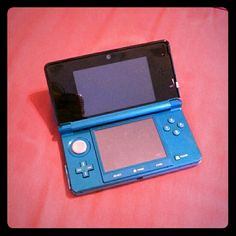 Nintendo 3DS aqua blue Used Nintendo 3DS aqua/blue/teal color. Includes an SD card.  *does not have pen or charger! Will not turn on until charged. Nintendo 3DS Other