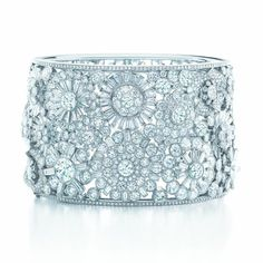 Tiffany diamond corsage bangle of round and baguette diamonds in pavé, bead and bezel settings, with milgrained and polished platinum, from the 2013 Blue Book Collection.