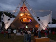 Festival stage covering,truss construction with tensioned membrane by Poly-Ned
