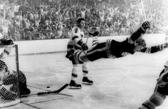 One of the most memorable moments in Hockey history: The goal that Bobby Orr scored assisted by Derek Sanderson to win Boston Bruins the Stanley Cup.