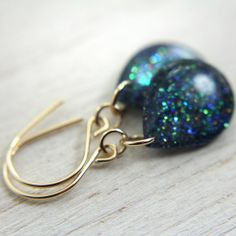 Los amo todos! iridescent blue green sparkly earrings on 14k gold by tinygalaxies, $24.00