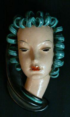 Goldscheider ceramic mask, blue black, red coloured on naturalistic ground,Viennaaround 1920