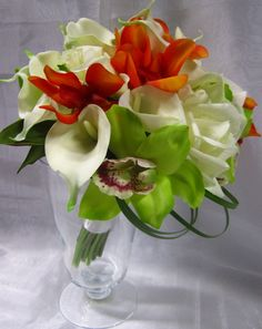callas, cymbid and vanda orchids, roses and bear grass; design by Davis Floral Creations
