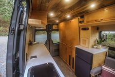 This van conversion was built for taking extended weekend trips, with a double drop down bed, large kitchen galley, and a modular bench seat with a dog bed. Van Conversion Build, Van Conversion Interior, Camper Van Conversion Diy, Patio Lighting, Interior Lighting, Motorhome, Tiny House Big Living, Build A Camper Van, Van Design