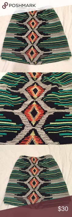 Soft Tribal Pattern Skirt Size Small Small soft and adorable tribal skirt. Black, hot pink, neon green, blue, black. Soft elastic waist with a hemline that falls right above the knee. Willow & Clay Skirts Mini