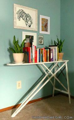 Distressed white chalk paint vintage wood ironing board repurposed into bookshelf living room makeover The DIY Homegirl