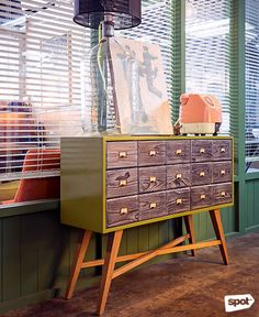 The Space Encounters office showcases consistent branding, a refined take on mid-century design through finishes and furniture, and thoughtful details. Cool Office, Mid Century Design, Manila, Offices, My Design, Cabinet, Cool Stuff, Space, Storage