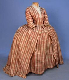PLAID SILK ROBE a la FRANCAIS, 18th C. Pink, green and cream plaid open gown having 3/4 sleeve and V neck, back with pair of double box pleats falling from the neck and stitched down 4 inches at the top, inverted pleats at front and back waist, bodice linen bodice lining with ties, matching petticoat pleated at waist with side ties and linen back panel. B-32, L-56, W-33, petticoat L-37.