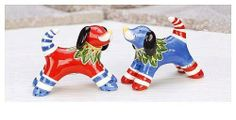 "Clayworks Red Dog Salt & Pepper Shakers - Blue Sky by Blue Sky. $14.99. 2.5"" x 3.5"". Boxed for giving. High gloss ceramic salt & pepper shakers. Clayworks designed by Canadian artist, Heather Goldmiinc. These adorable pooches would love to join you for dinner."