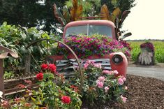 old truck filled with flowers - Google Search