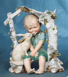 DELIGHTFUL GERMAN BISQUE BABY WITH PACIFIER AND RABBIT. : Lot 174