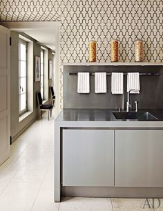 Moroccan-inspired wallpaper by Phillip T. whealon - Jeffries enlivens the kitchen; the faucet is by Dornbracht, and the cabinetry is by Strato.
