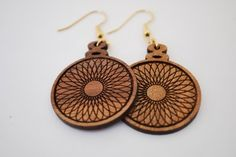 Blast from  the past. These remind me of the years gone by spirograph.  Made of solid hardwood and fun to wear. www.etsy.com/shop/realwoodjewelry