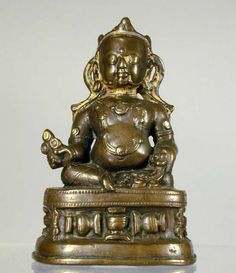 century, Tibet, Yellow Jambhala, copper alloy with traces of cold gold, at the Pacific Asia Museum. Tibetan Buddhism, Buddhist Art, Tibet Art, Vajrayana Buddhism, Bronze, Himalayan, Cold, Sculpture, Statue