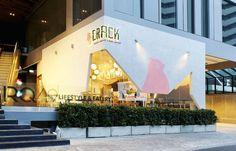 This modern dessert restaurant in Bangkok, Thailand, has an angular facade, much like a cracked egg shell.