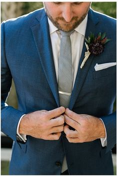 Look at those colors? Steel gray tie with a deep blue suit and the boutonnière brings a unique feel to the whole outfit. Deep Blue Suit, Blue Suit Brown Shoes, Bright Blue Suit, Royal Blue Suit, Blue Suit Men, Navy Blue Suit, Blue Suits, Cobalt Blue, Blue Suit Groom